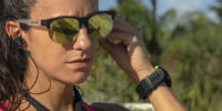 woman runner earbuds sunglasses